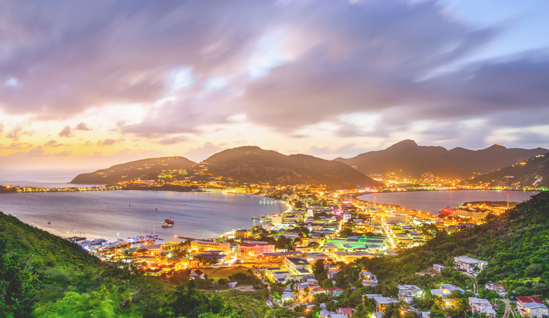 Nighttime Aerial View Of Hills, Coves, and City in St Martin